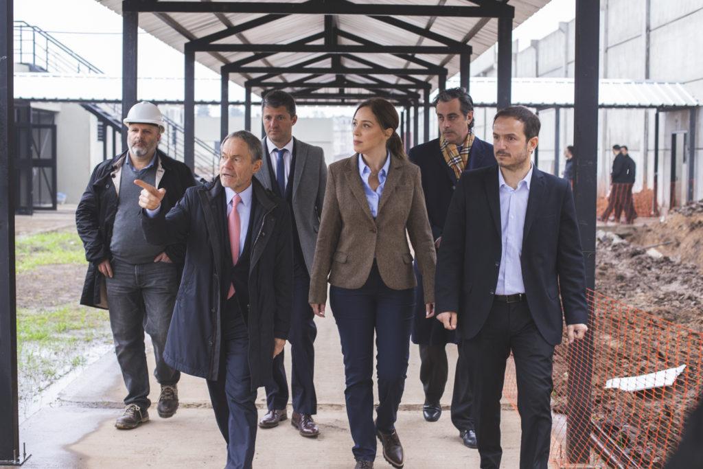 Vidal junto a Ferrari y Abella, durante la recorrida